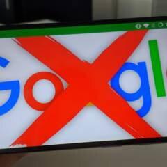 Durchkreuztes Google-Logo auf Smartphone