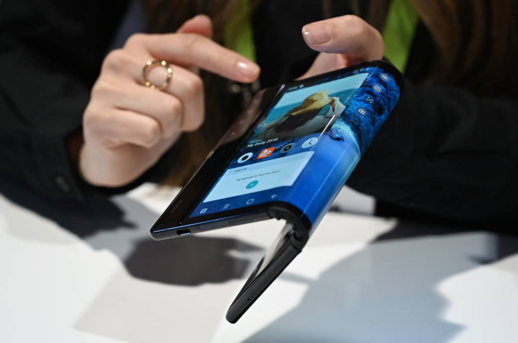The folding and capabilities of the Royole FlexPai tablet and phone are demonstrated at the Royole booth at CES 2019 consumer electronics show, January 8, 2019 at the Las Vegas Convention Center in Las Vegas, Nevada.